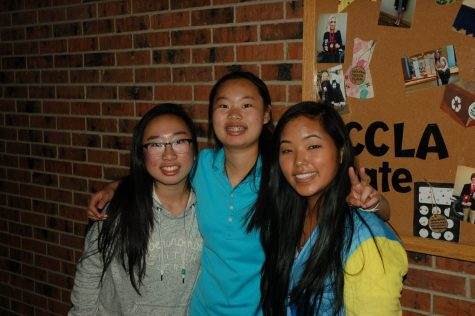 Cultural ARMS club members Amy Dong, Angel Dong, and Mira Eisele pose for a photo.