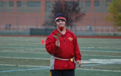 Senior, Andy Bishop, with a flower that was presented to him at senior night.