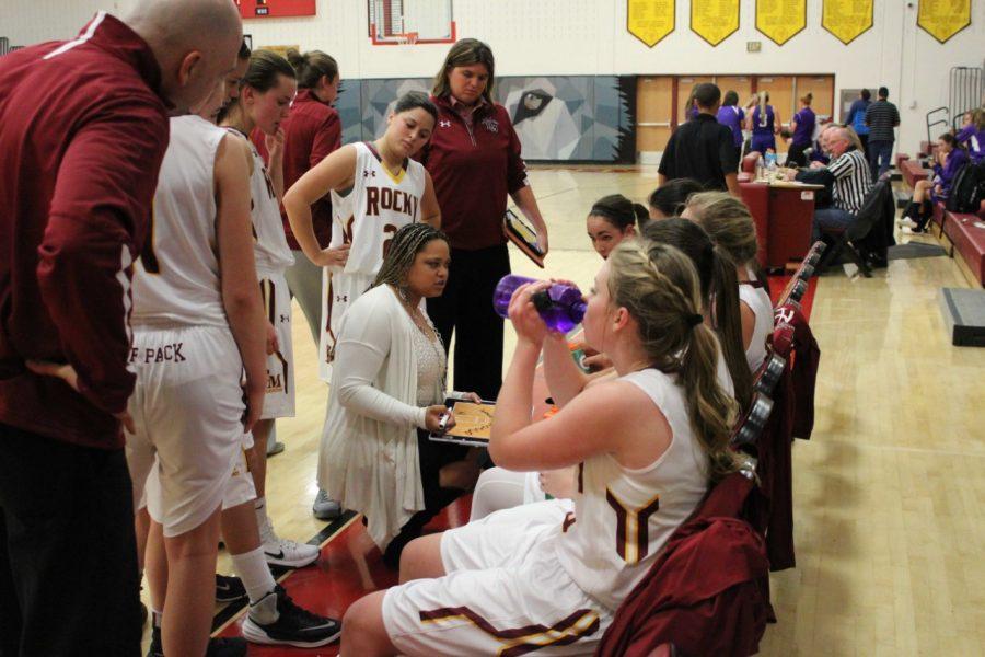 New basketball coach talks to team