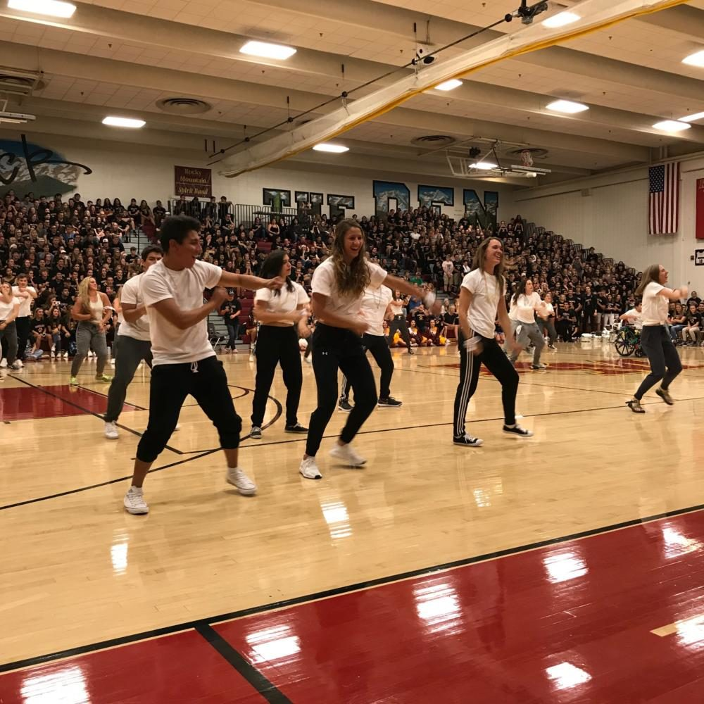 Peers dance at the back to schools assembly