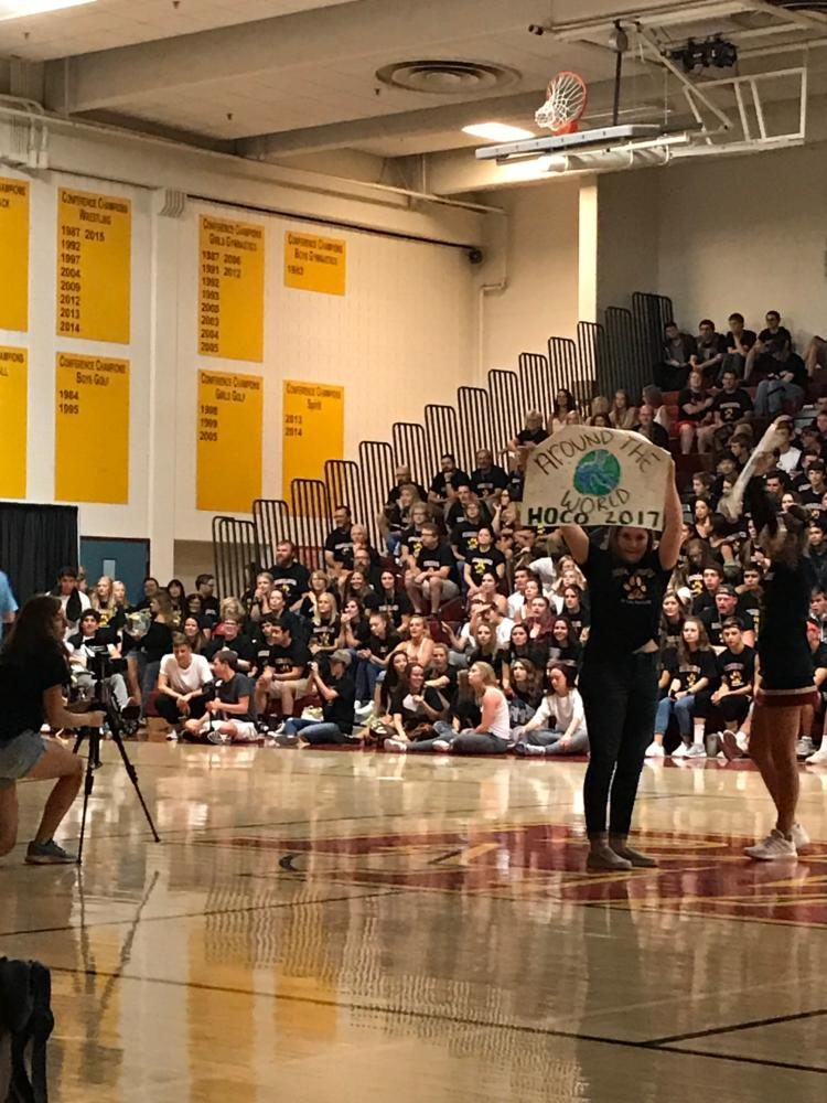 Homecoming reveal at back to school assembly around the world.