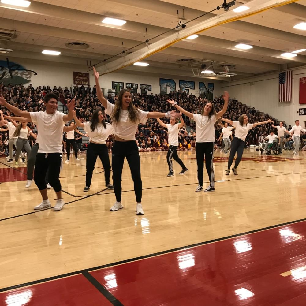 Peers dance at back to school assembly
