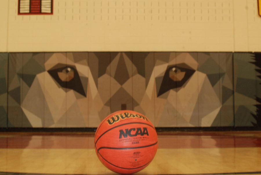 Photo of basketball in gym for Girls basketball story.