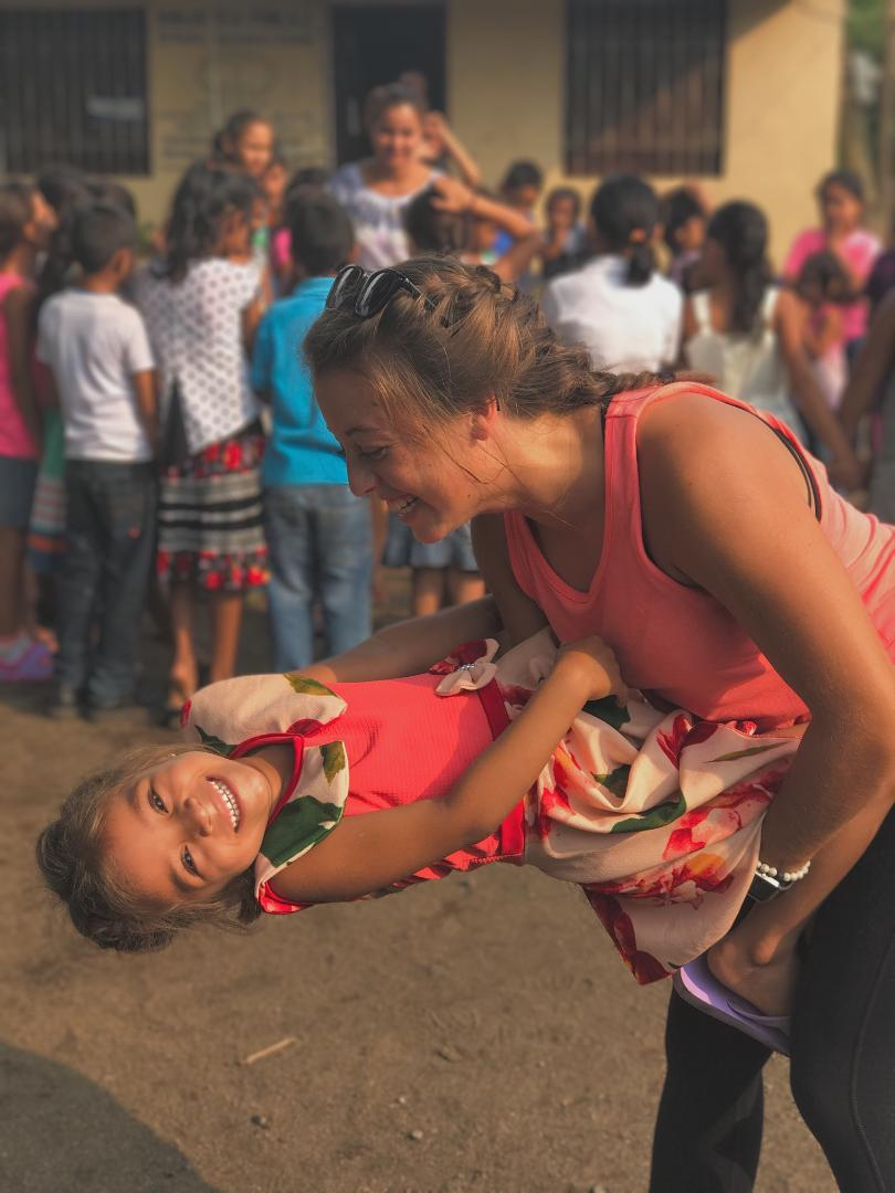 2017 Rocky grad Natalie Bradshaw plays with a child while volunteering during her gap year in Nicaragua. More students are pursuing a nontraditional path post-graduation. Contributed photo.