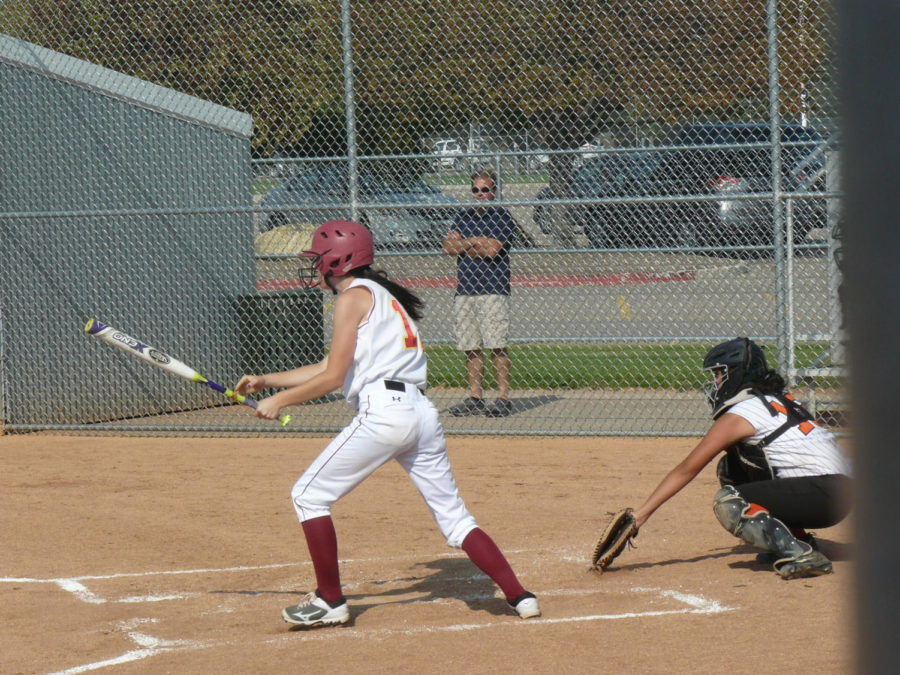 C teams catcher Evee Caramanno hits the ball and gets on base.