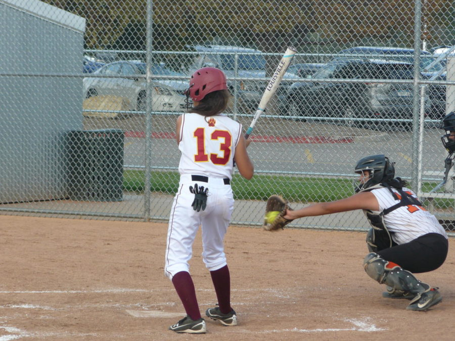 Olivia avoids a bad pitch.
