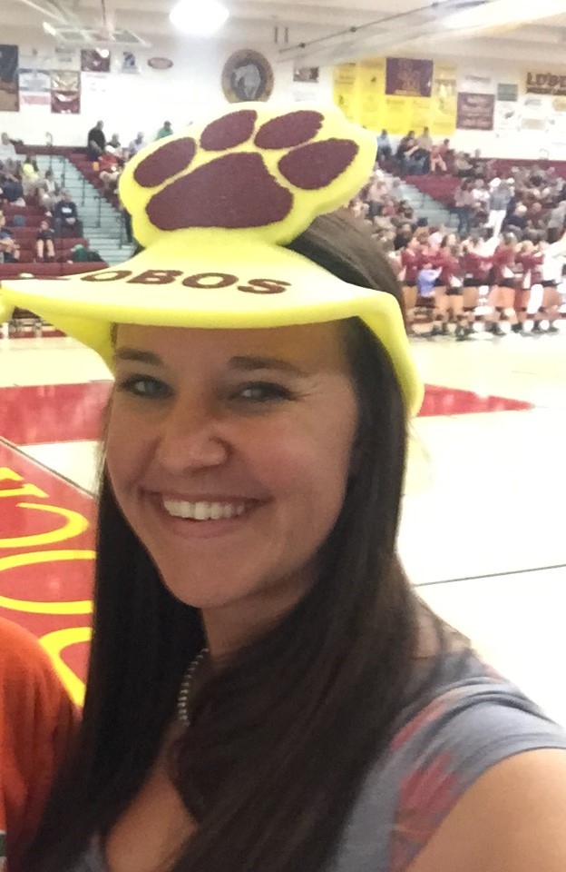 New StuCo advisor Ms. Kelsey Mauch cheers on the 'Bos at one of Rocky's volleyball games, dressed in her Rocky gear.
