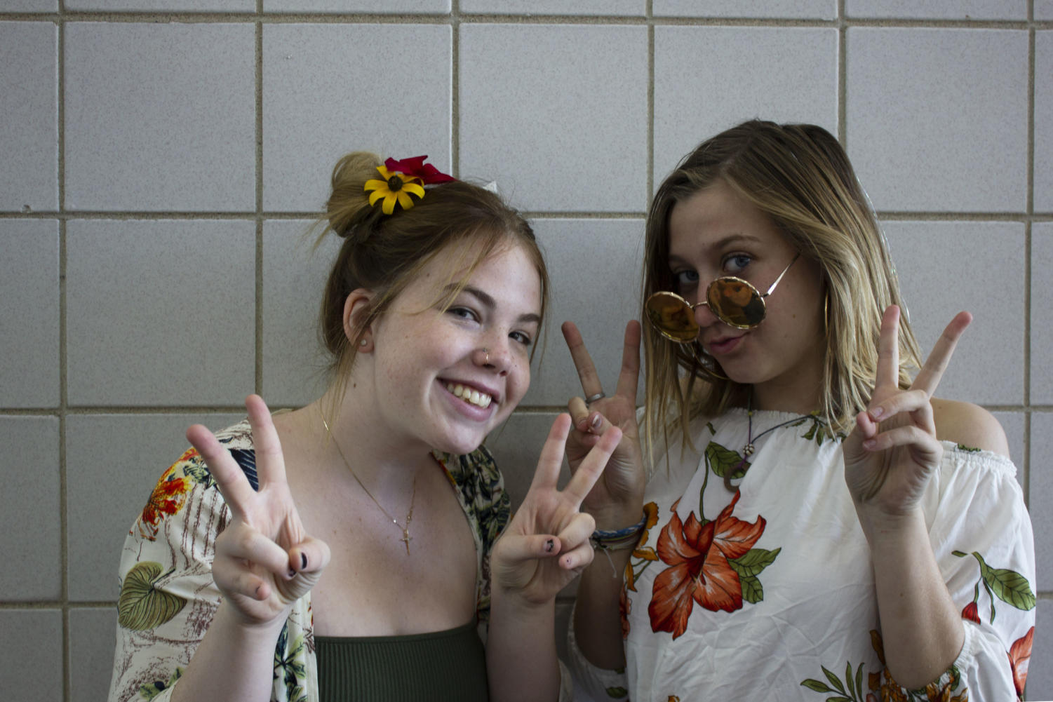 Seniors Abi Loughrey and Caroline Morris peacefully show spirit with the 3rd day--flower power!