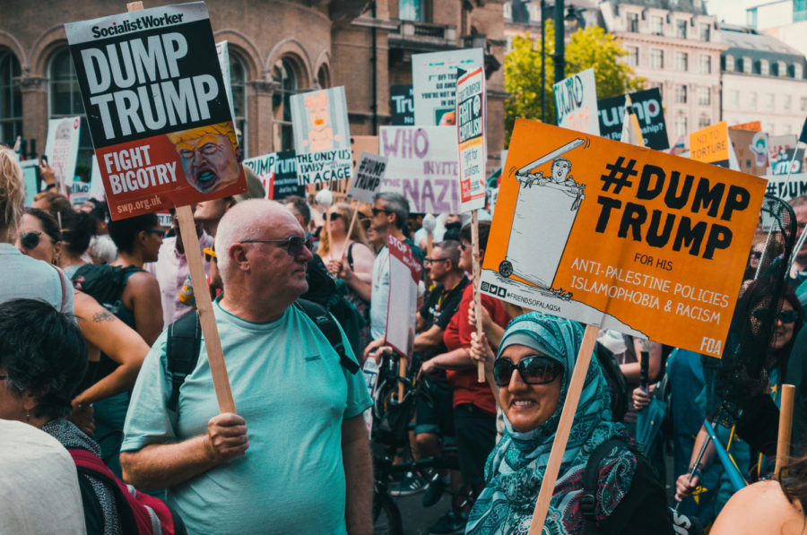 Protesters standing against Trump.