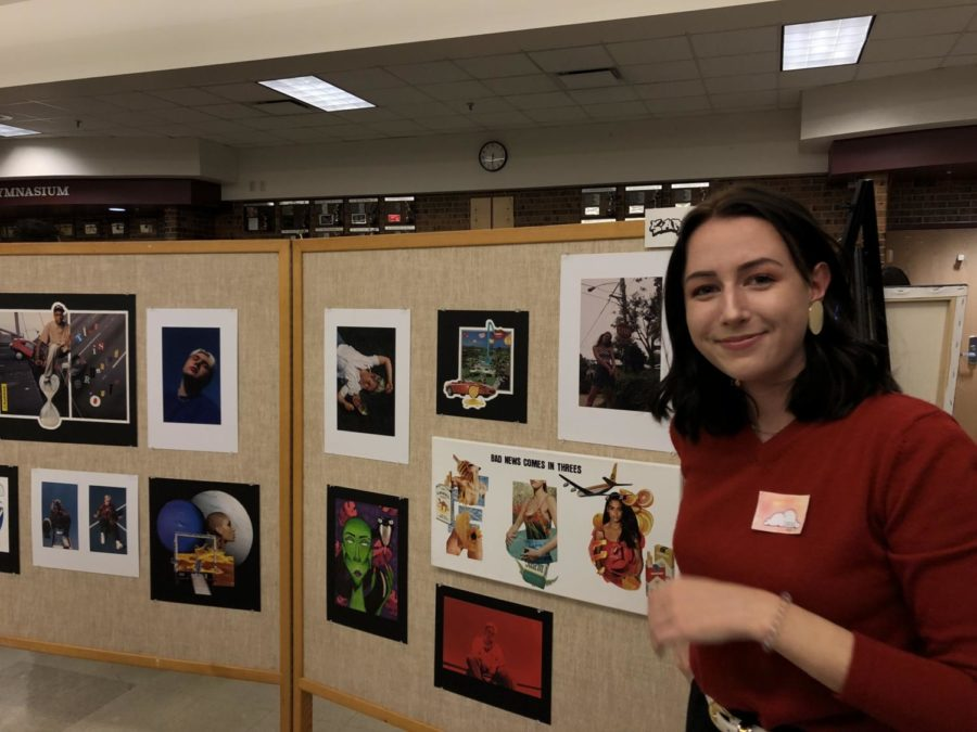 Sarah Eley poses proudly in front of her display, knowing all the hard work for this semester has paid off.