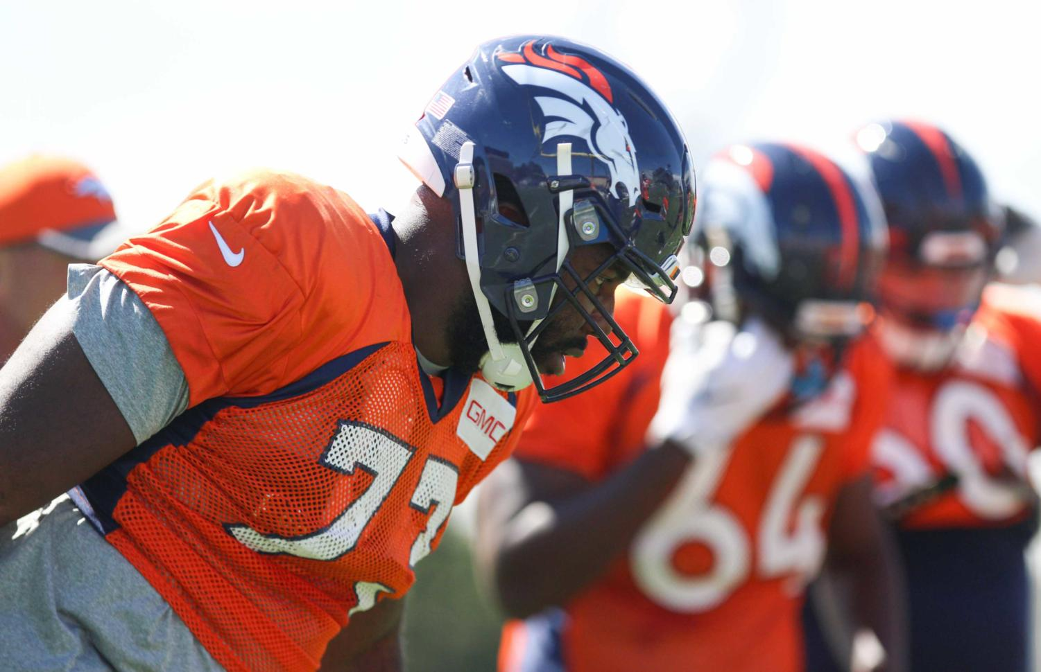 Russel Okung lines up at Broncos practice.