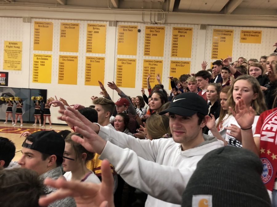 Students continue the tradition of cheering on free throw shots.