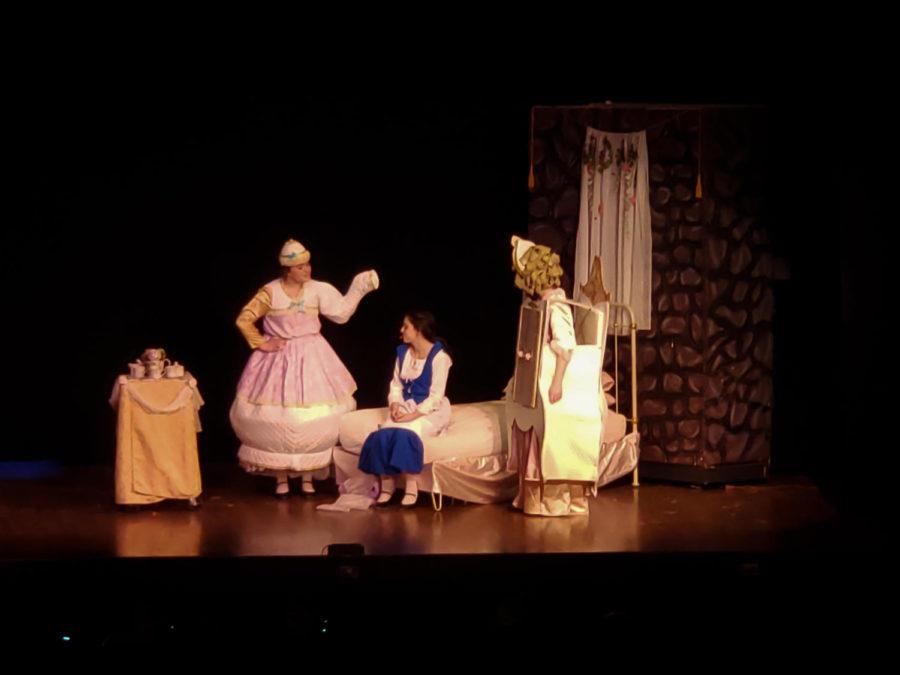 Mrs.+Potts+%28Emma+Stone%29+and+Madame+De+La+Grande+Bouche+%28Adeline+Becker%29+welcome+Belle+%28Tessa+Barker%29+to+the+castle.