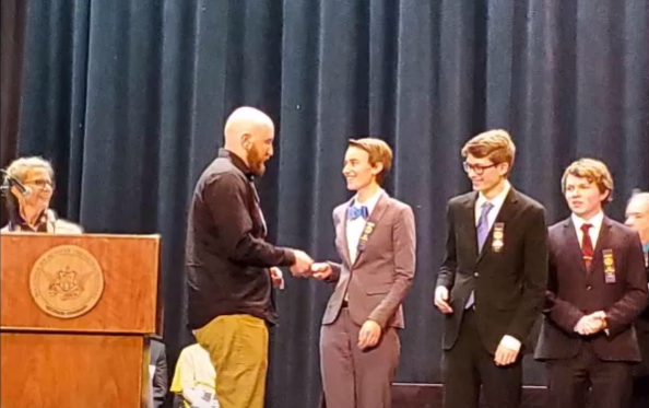 RMHS Alumni Abby Roberts (middle) and Ben Davis (second to the right) accept a ribbon for placing in their respective events.