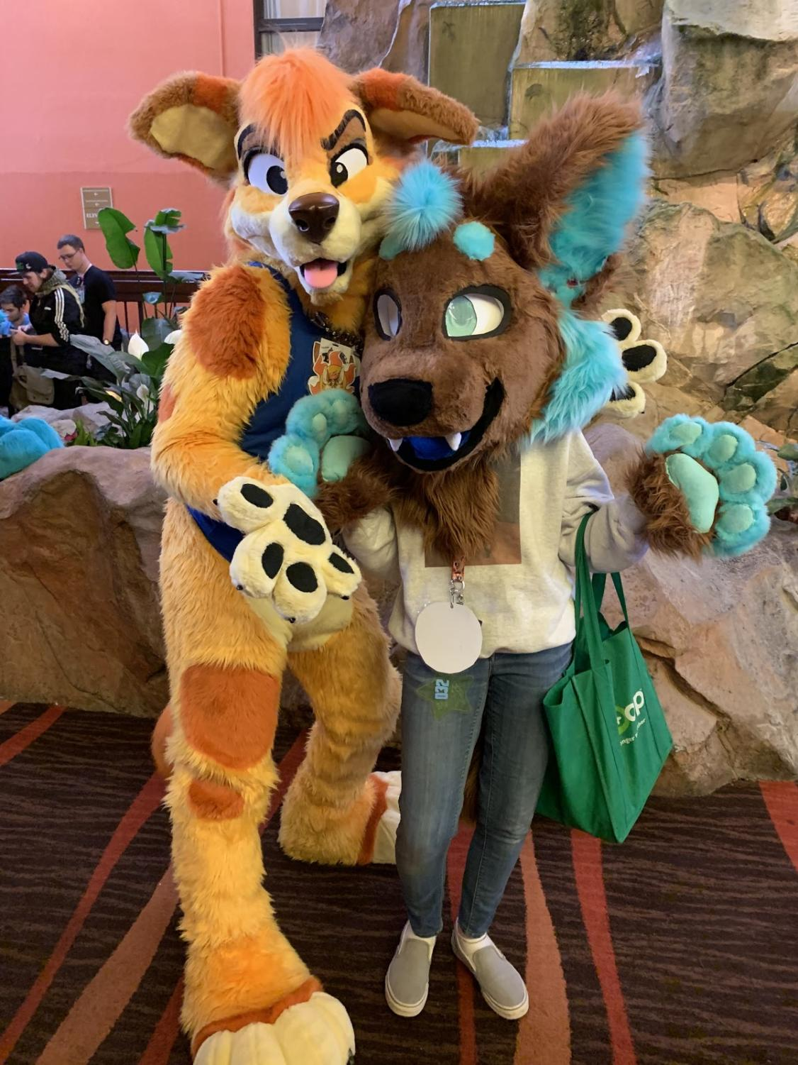 Liddle (right) and a friend (left) wear their fursuits.