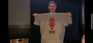 Colin Richie shows off his prize for completing the Blazin' Wings Challenge at Buffalo Wild Wings.