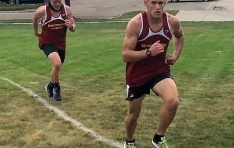 Matt Kinerson and Kolton Strait battle up a hill during a race at Fort Collins High school.