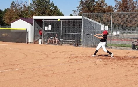 Shay Salazar, RMHS starting varsity first baseman hits to deep left field for a double.