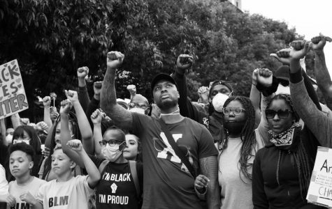 Portland Trailblazers Pont Guard Damian Lillard, stands peacefully at a Black Lives Matter Protest.