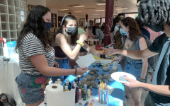 RMHS Peers Adilyn Prutch and Camille Long-Shore help students decorate rocks for the Peers Kindness Rock Garden at the No Place For Hate event.